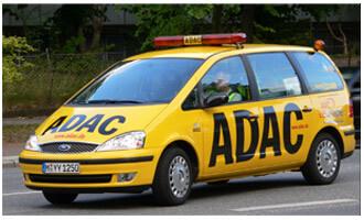 Bild das einen gelben Wagen mit Logo des ADAC zeigt